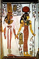 Queen Nefertari and Isis. Wall painting in the tomb of Queen Nefertari. It portrays the ancient Egyptian goddess Isis right leading Queen Nefertari by...