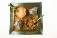 Asian ceramic bowls containing sugar scrub and bath salts