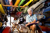 Senior woman in kayak shop, portrait