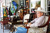 Florida, Kissimmee, Broadway Street, Lanier´s Historic Downtown Marketplace, antiques, collectibles, man, older, cowboy attire, sidewalk sale, chairs,...