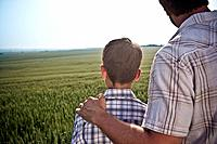 Father and son in wheat_field