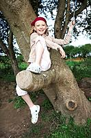 Young girl in tree