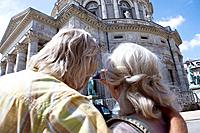 Couple taking picture of church (thumbnail)