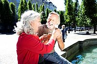 Couple with ice-cream, laughing (thumbnail)