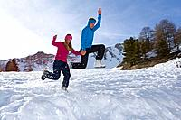 Couple at ski, jumping