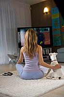 Woman and dog watching tv (thumbnail)
