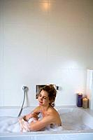 Woman in bathtub, relaxing