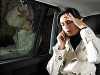 Woman in car, on the phone