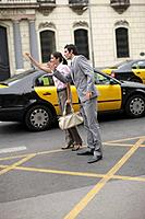 Business team hailing cab