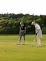 Two women at golf green