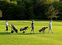 Three women on a golf fairway