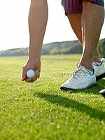 Woman on golf tee (thumbnail)
