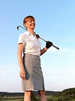 Woman on golf tee