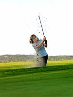 Woman in golf bunker