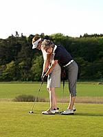 Two women on golf green
