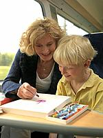Grandmother and grandson on train (thumbnail)