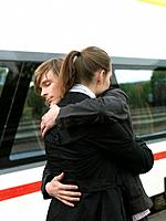Couple embracing on train station