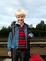 Boy on train station