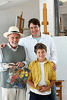 Three generations painting in art studio