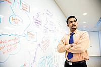 Indian businessman standing in front of whiteboard