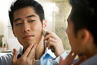 Korean man shaving