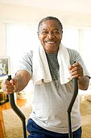 African man working out on exercise equipment