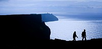 Cliffs Of Moher, County Clare, Ireland, Silhouette of hikers on coastal cliff