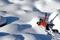 Woman lying in the snow, Jasper National Park, Alberta, Canada