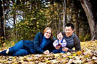 Portrait of family sitting in leaves
