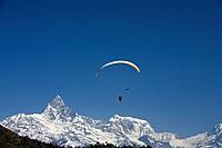A paraglider in the Annapurna Region near Pokhara, Nepal