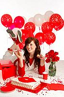 Girl with cake and red balloons