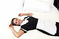 Maid lying on freshly made bed