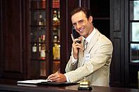 Concierge on telephone