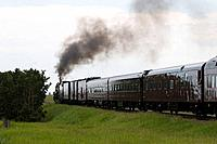 Old Fashioned steam locomotive with passenger cars. Canada
