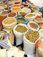 Bags of pulses and beans at market stall, Sicily, Italy