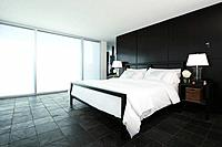 Slate tiled bedroom in upscale home