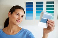 Woman holding paint sample