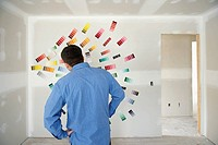 Man looking at paint samples