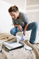Woman pouring paint