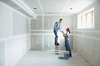 Couple working on new room