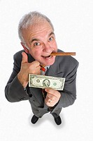 Portrait of senior business man with cigar and dollar bill