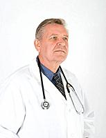 Male doctor with stethoscope around neck, upper half