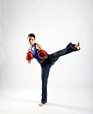 Female kick boxer, studio shot