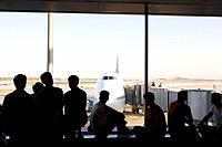 Silhouette of businesspeople waiting at international airport