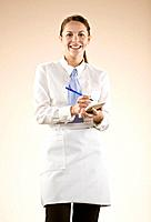 Young waitress smiling, portrait