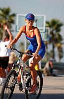 A woman on a streetbike, Mountainbike at Venice beach, California, USA, MR