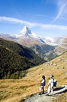 Couple hiking, enjoying the view to the Matterhorn 4478 metres, Sunnegga, Zermatt, Valais, Switzerland