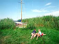 Girls having a rest, Bodstedter Bodden, Fuhlendorf, Fischland_Darss_Zingst, Mecklenburg_Western Pomerania, Germany