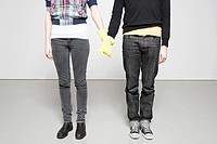 Couple in rubber gloves holding hands