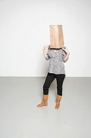 Woman with paper bag on her head